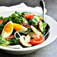 Spinach-Salad-Served in a white ceramic bowl featured