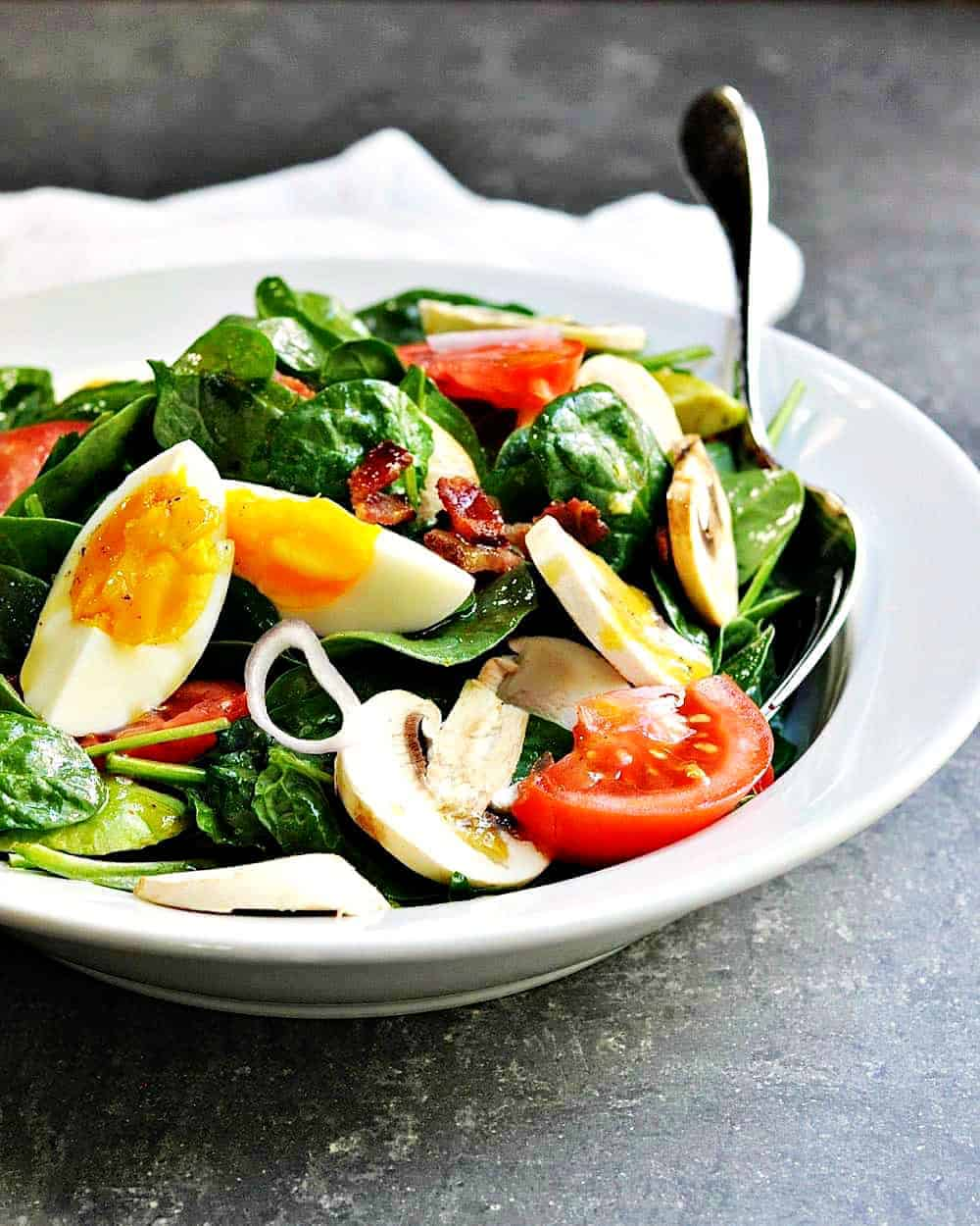 Spinach-Salad-Served in a white ceramic bowl