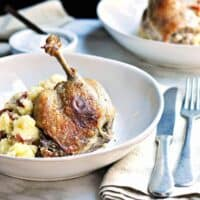 Easy Duck Confit Served in Shallow Bowls with mashed potatoes featured
