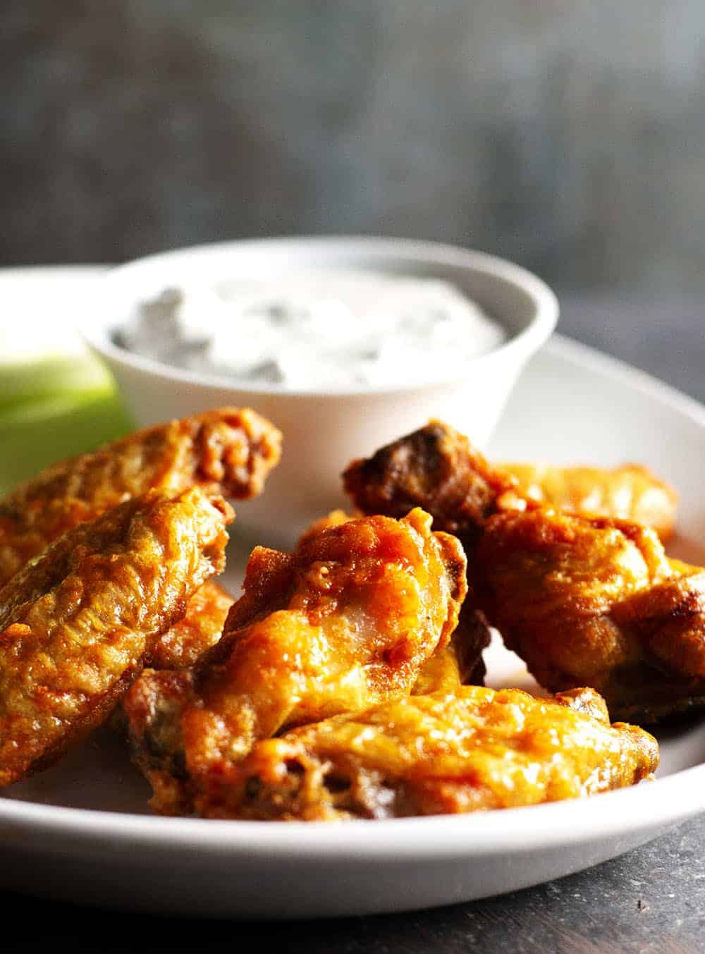 Crispy Baked Buffalo Wings served with blue cheese dip