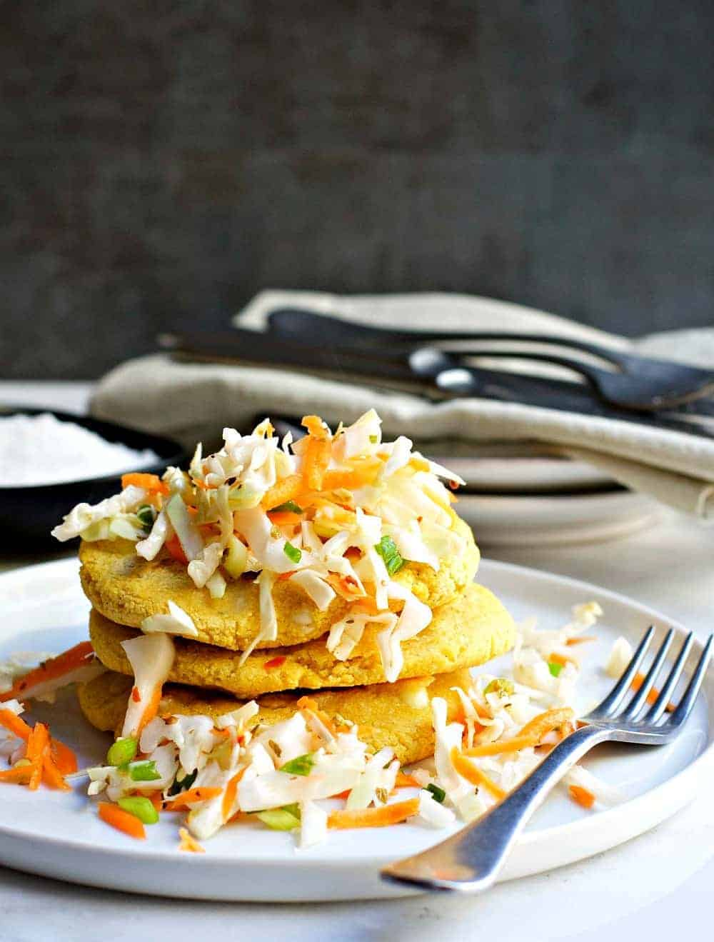 Delicious Pupusas stacked high and smothered in Curtido (spicy slaw).