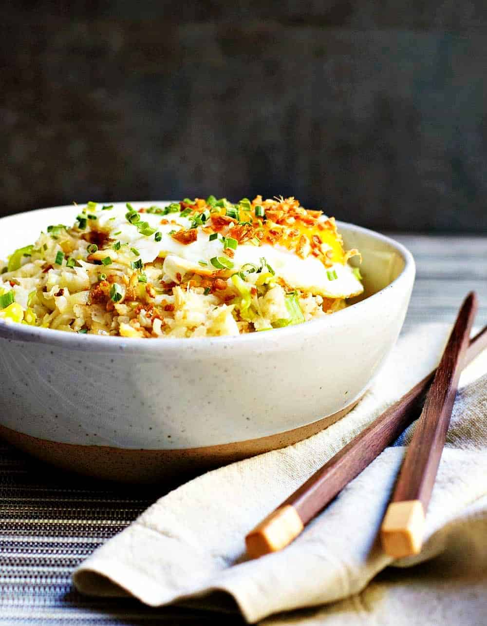 Califlower-Fried-Rice in ceramic bowl with Chopsticks and Napkin