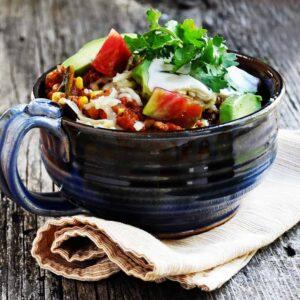 chorizo chili served in a blue ceramic bowl