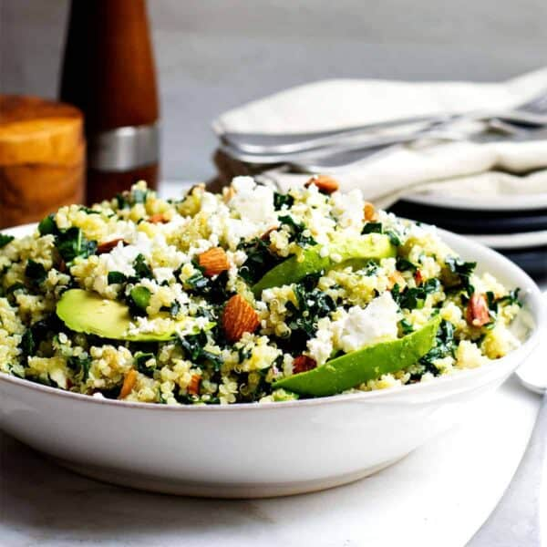 kale and quinoa salad served in a white bowl
