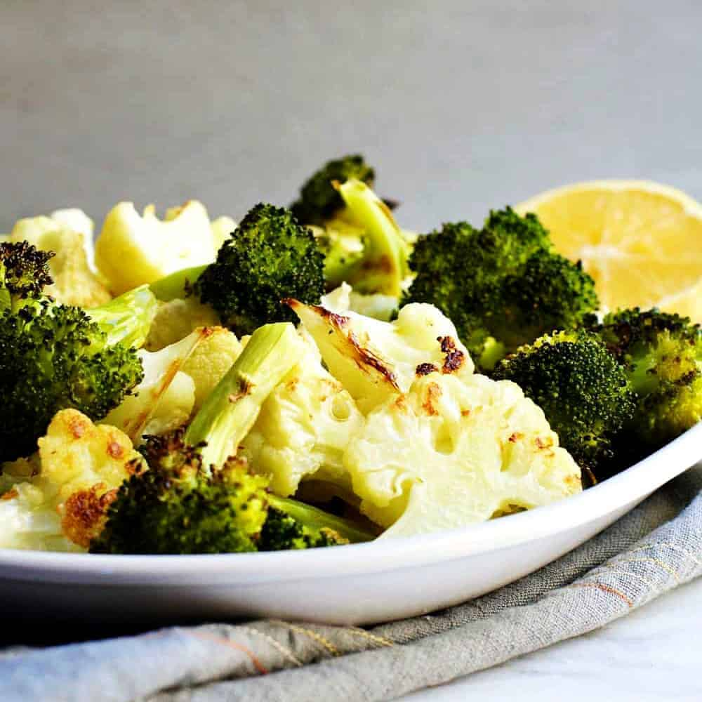 Roasted-Broccoli-and-Cauliflower-Served on a white platter