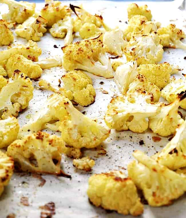 Roasted-Cauliflower on a parchment lined baking sheet