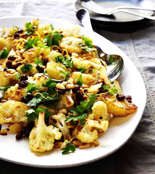 Roasted-Cauliflower-with-Pine-Nuts-and-Raisins served on a platter