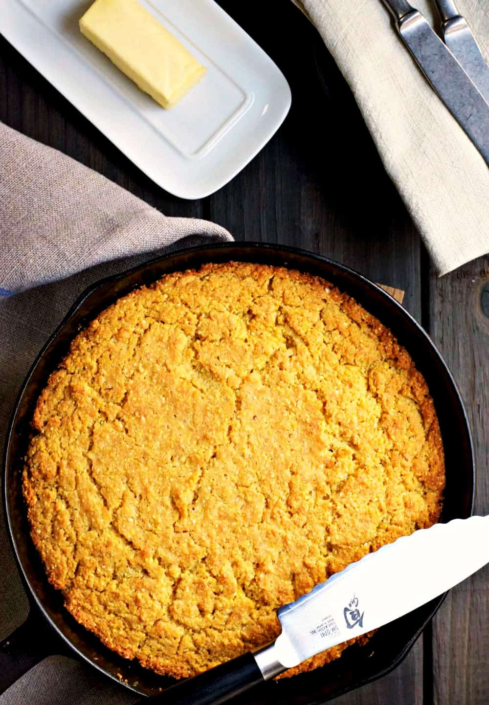 Skillet-Cornbread-with-knife-butter and napkins