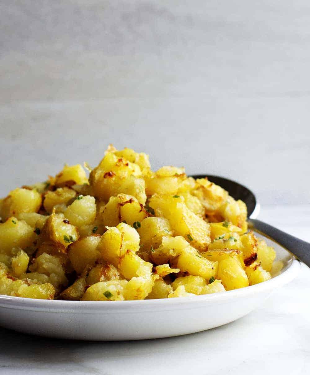Crispy Breakfast Potatoes Served on a White Platter