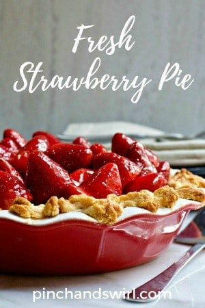 Fresh Strawberry Pie served in a red and white pie dish.