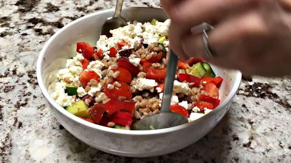 Gently Tossing Greek Farro Salad