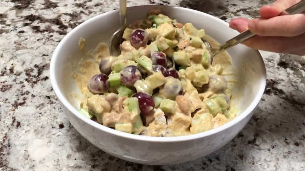 Tossing Curry Chicken Salad to coat