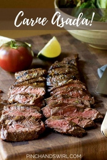 carne asada steak sliced thinly on a cutting board