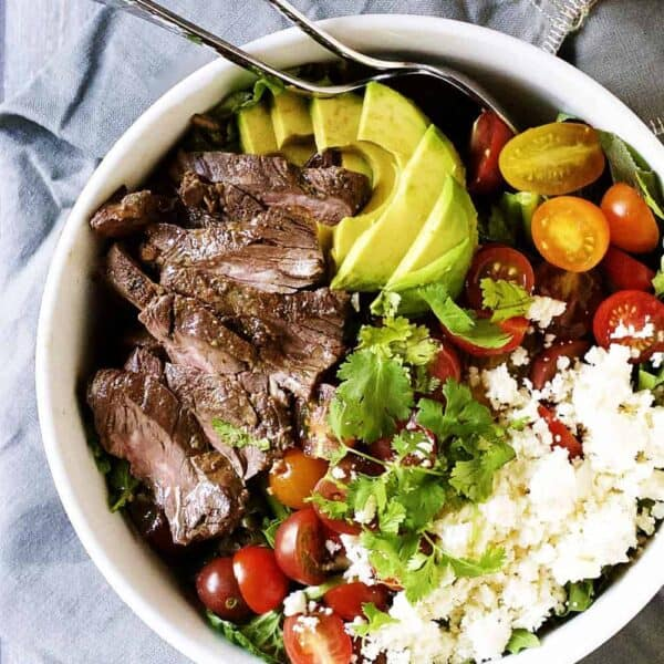 Carne-Asada-Steak-Salad served in a white bowl