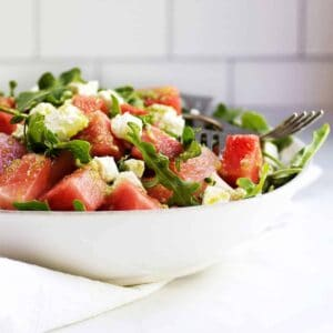 Watermelon and Arugula Salad with Feta Cheese served in a white ceramic bowl