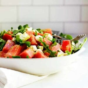 Watermelon-and-Arugula-Salad-with-Feta-served-in-a-white ceramic-bowl
