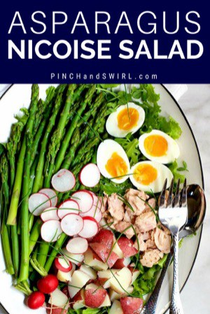Asparagus Nicoise Salad served on a white platter