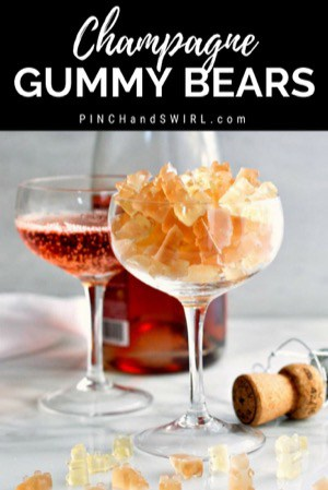 homemade champagne gummy bears served in a champagne coupe glass
