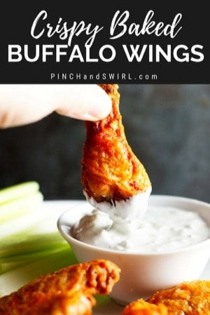 dipping a crispy baked buffalo wing in blue cheese dressing