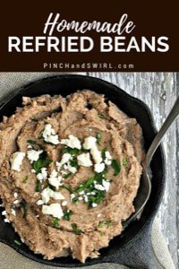 Homemade refried beans served in a small cast iron skillet
