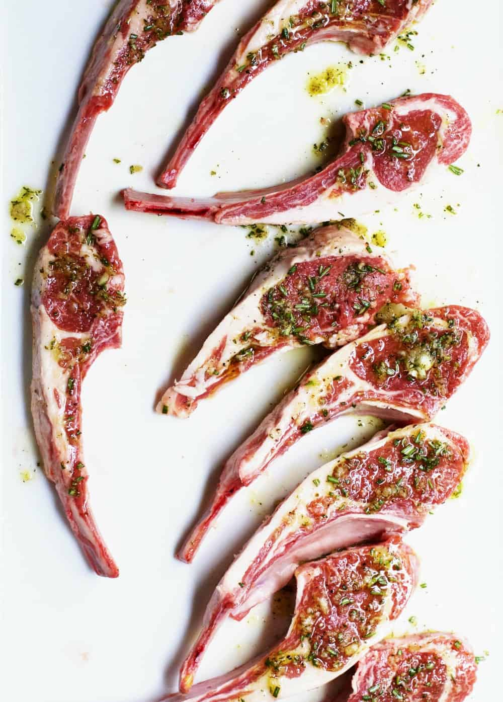 Lamb Chops on a White Platter Ready to Grill