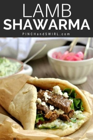 Lamb Shawarma served with pickled red onions and tzatziki in the background