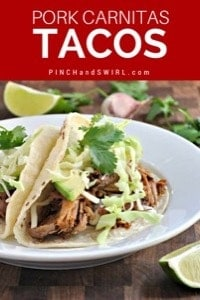 Pork carnitas tacos served on a white plate.