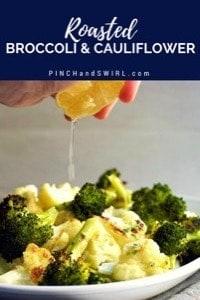 squeezing lemon over roasted broccoli and cauliflower