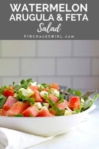 Watermelon and Arugula Salad served on a white plate