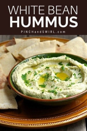 White bean hummus served with wedges of pita bread