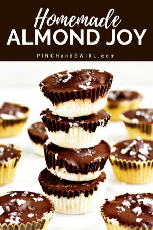 Homemade Almond Joy bars stacked on marble board