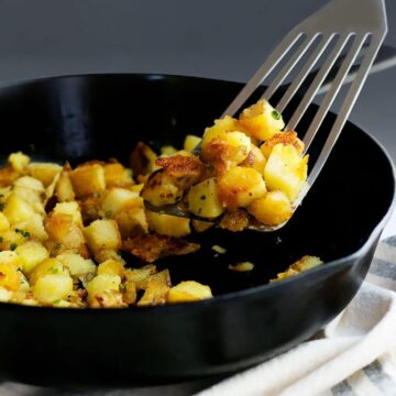 Skillet_Potatoes_on spatula in_a_Cast_Iron_Skillet