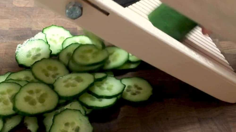 Slicing cucumbers with a mandoline