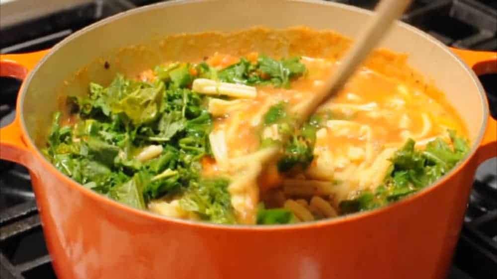 Stir Pasta e Fagioli soup and simmer