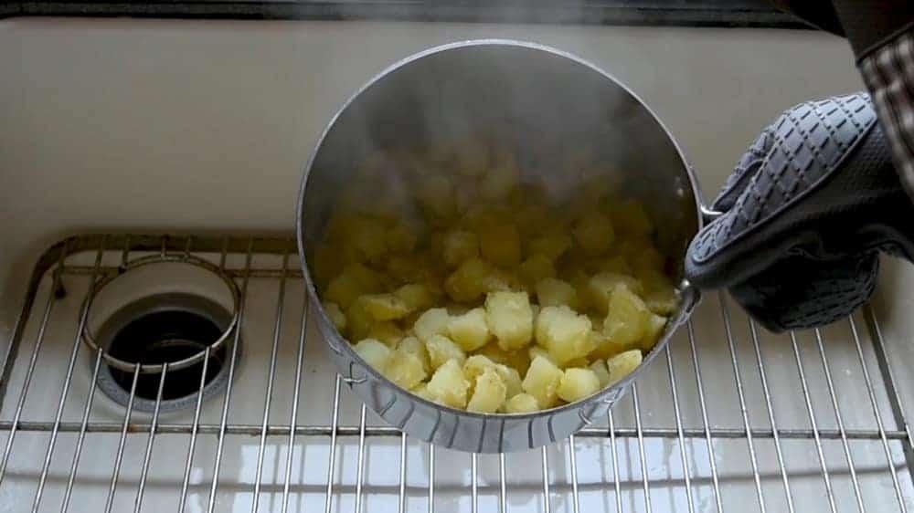par boiled potato cubes after shaking