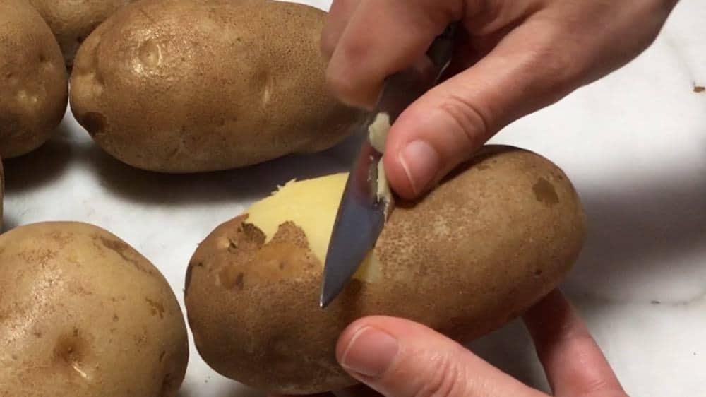 peeling par boiled potatoes