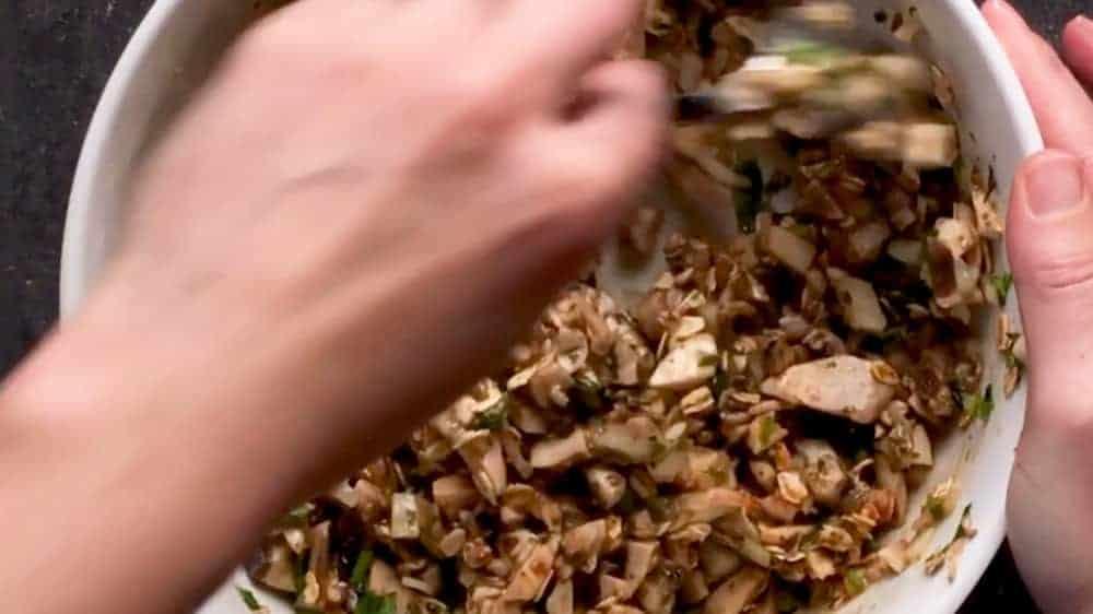 Combining turkey meatloaf ingredients