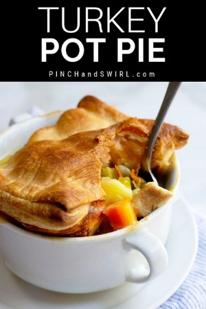 turkey pot pie with puff pasty served in a white dish