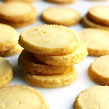 Butter Cookies stacked on a marble slab