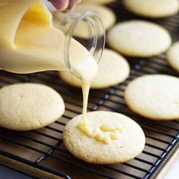 Sugar Cookie Icing pouring over soft sugar cookies