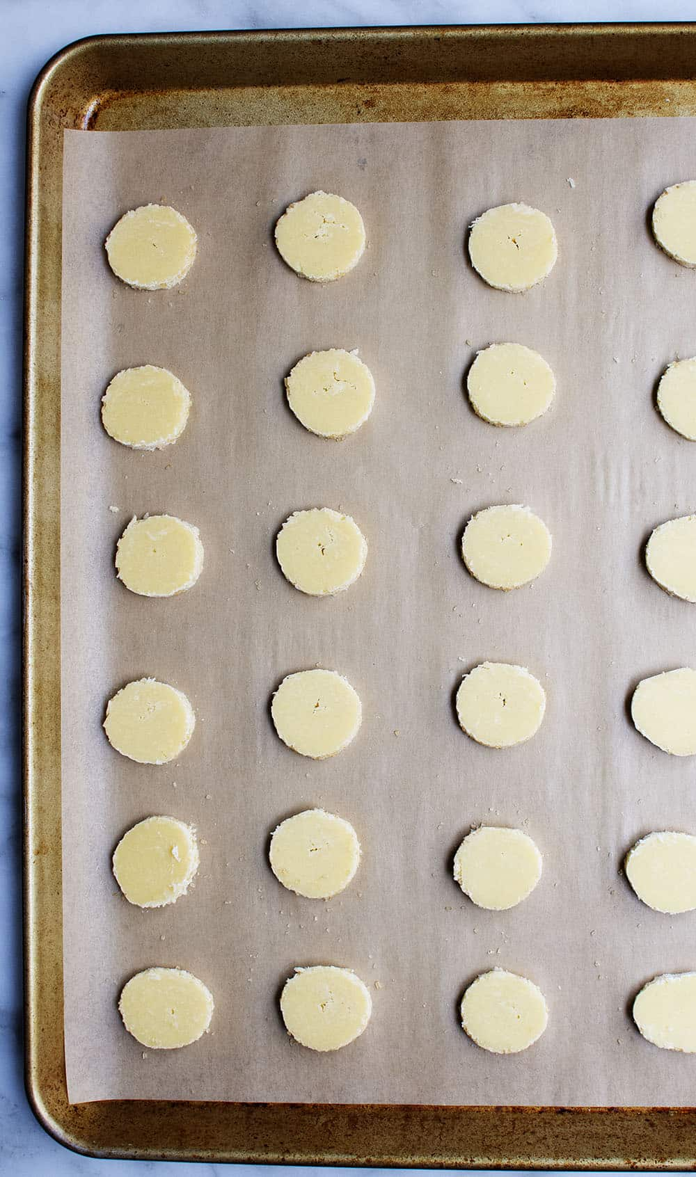 butter cookie dough rounds ready to bake