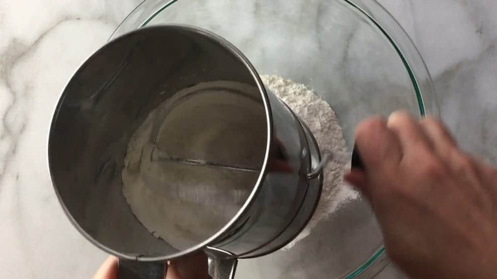 sifting dry ingredients together