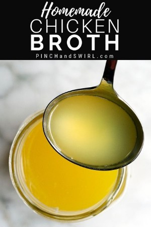 homemade chicken broth in a stainless steel ladle