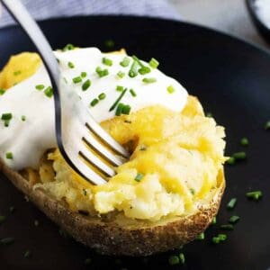 Twice Baked Potatoes on black plate