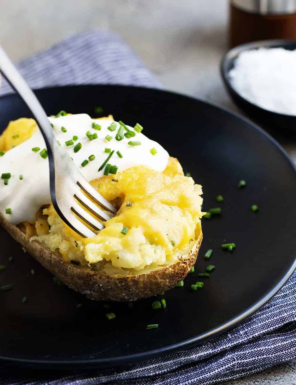 Twice Baked Potatoes served on black plates