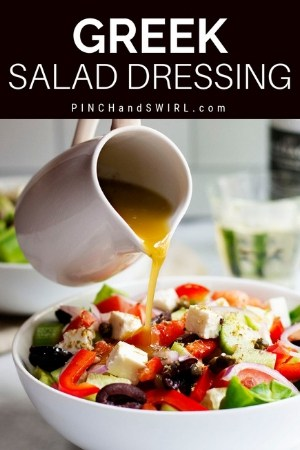 pouring greek salad dressing from a white pitcher