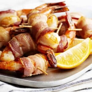 Bacon Wrapped Shrimp served on a stainless platter featured
