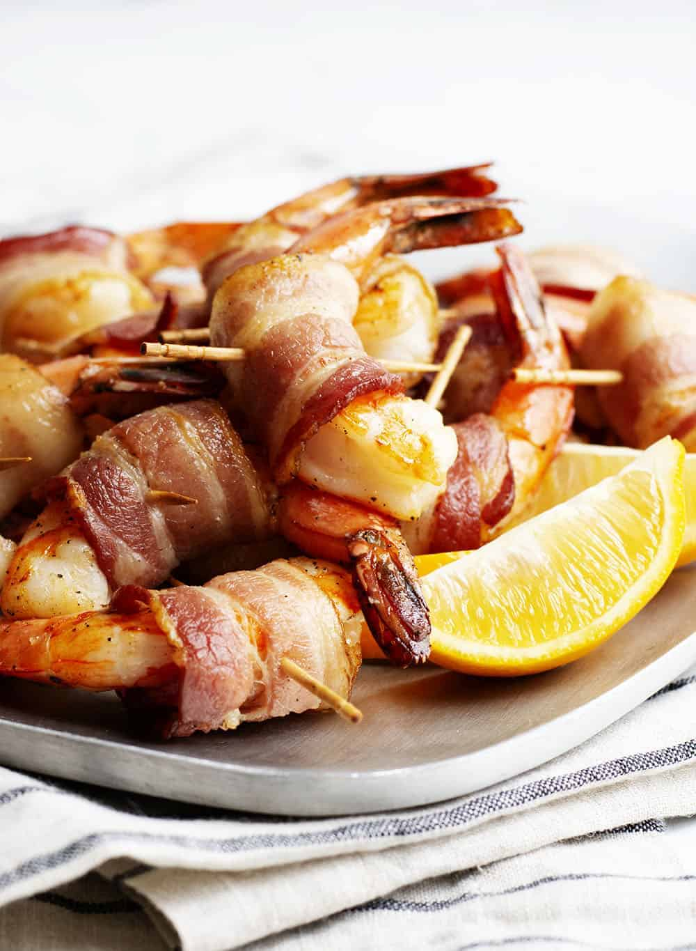 bacon wrapped shrimp served with lemon wedges
