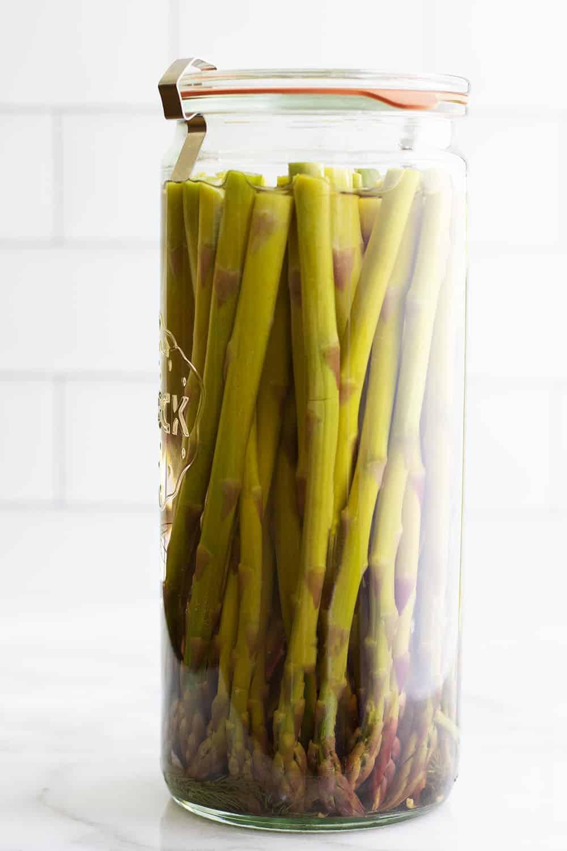 Pickled Asparagus in a tall glass jar