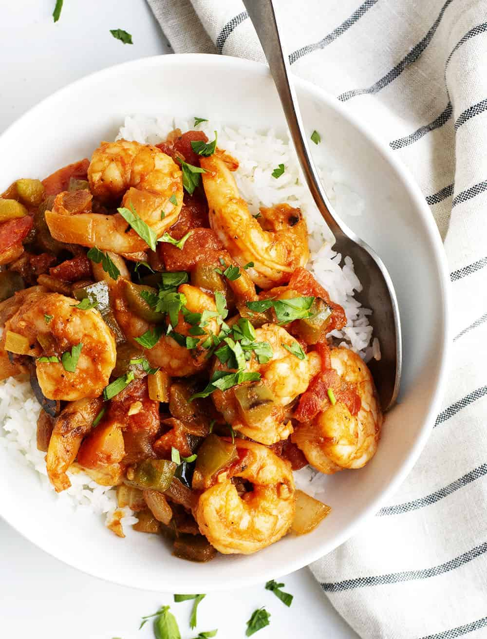 Shrimp Creole served over rice in a white bowl